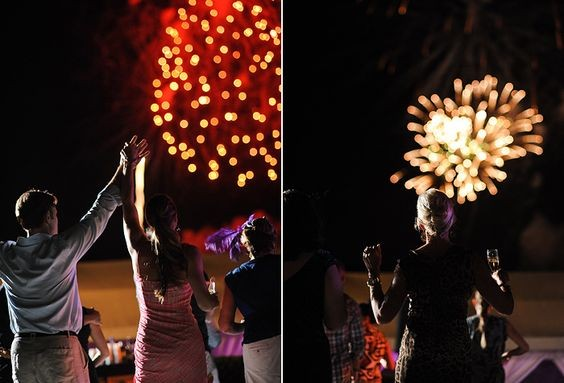 Wedding guests enjoy fireworks at a destination wedding at One&Only Ocean Club in the Bahamas.