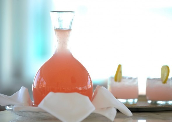 A carafe and two glasses of a Bahamian cocktail.