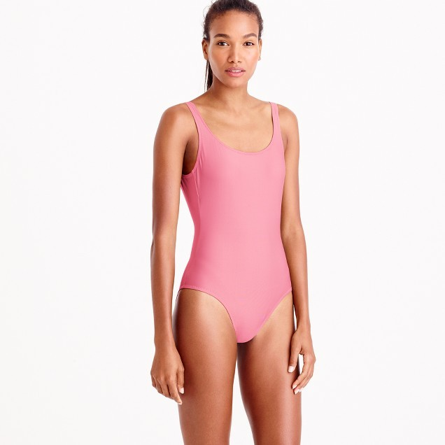 A woman in a pink one-piece swimsuit by JCrew