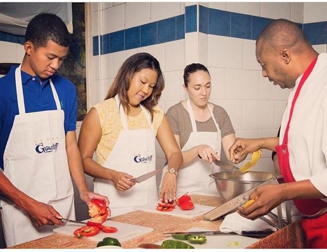 People attending a chef-guided food class.