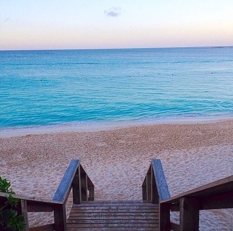 A staircase leads to a beautiful Bahamas beach