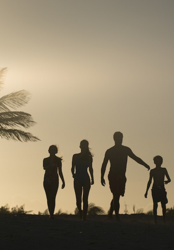 Silhouette of a family of four walking towards the Beach Towers at Atlantis, Paradise Island