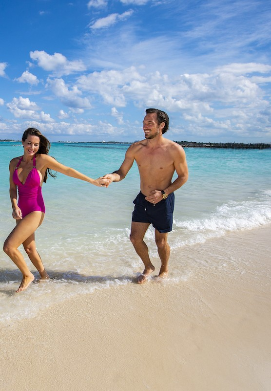 A couple running on the beach in Nassau Paradise Island