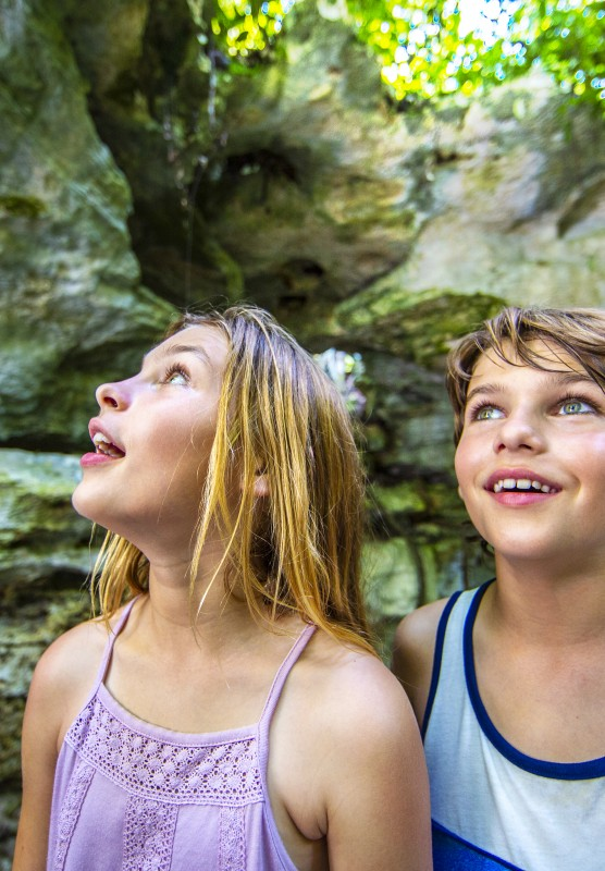 Two kids take in the underground caves in The Bahamas.
