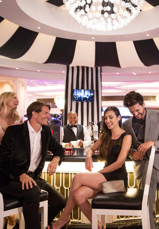 A group of young people sitting at a casino bar