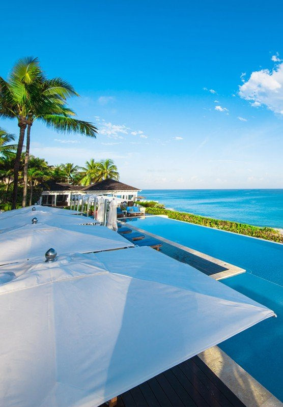 An infinity pool with stunning views of turquoise tropical waters.