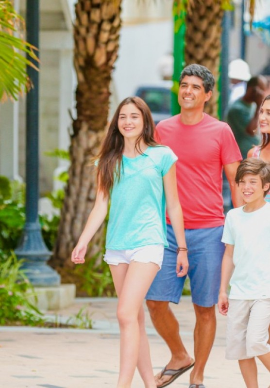 A family of four walks on a street in Nassau, Bahamas