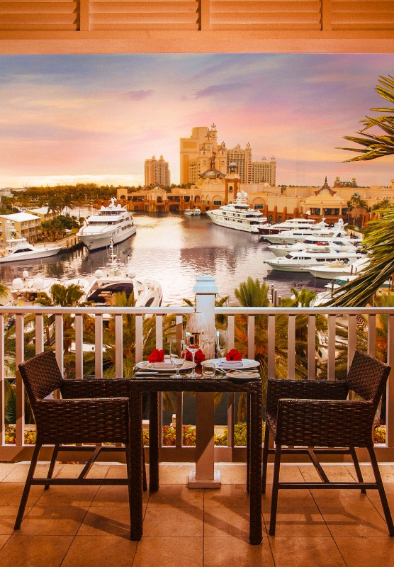 Cafe Martinique: beautiful cafe balcony looking out onto a harbour at sunset