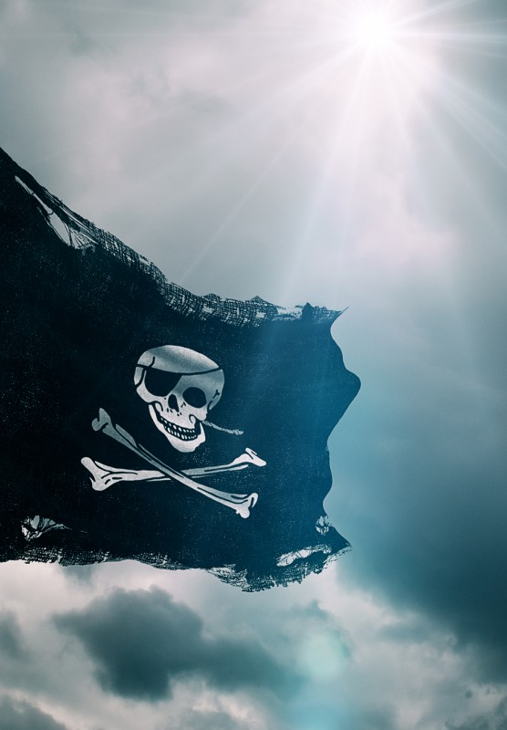 The Jolly Roger Pirate Flag flaps in the breeze.