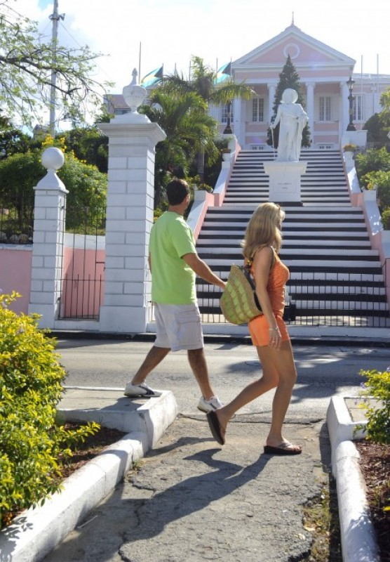 Man and woman walking in front of government house