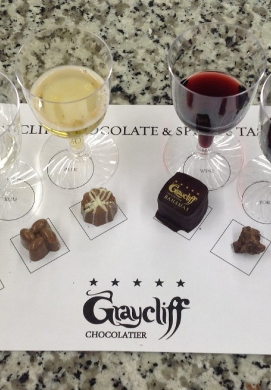 Glasses of alcohol and chocolate laid out on a table