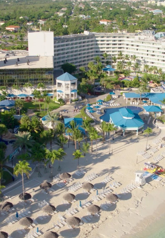 Aerial view of beach and large hotel