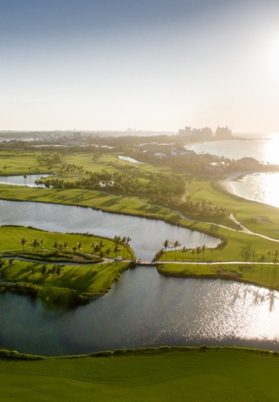 An aerial view of the Ocean Club Golf Course in The Bahamas at sunrise.