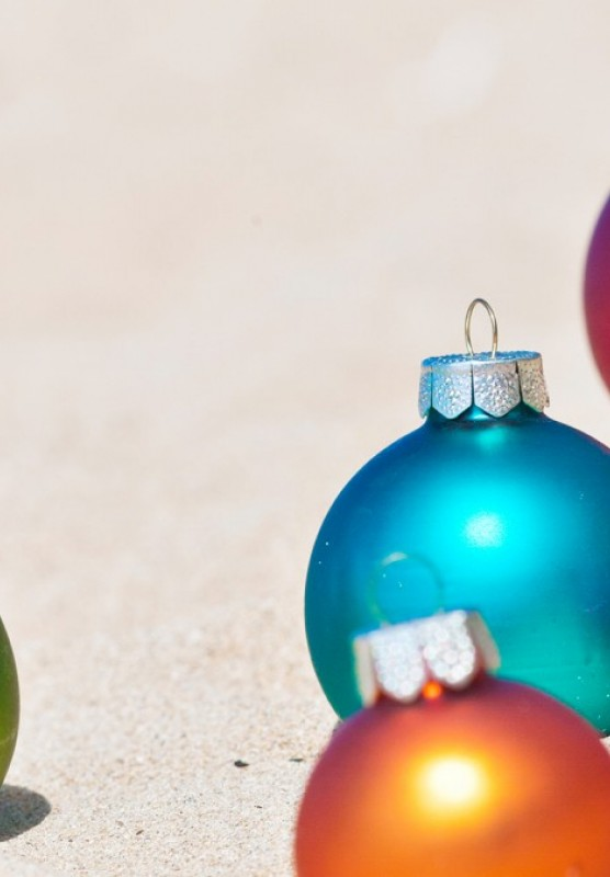 Holiday ornaments on a white sand beach
