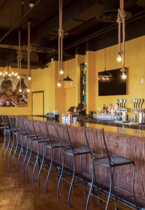 Pirate Republic Brewery: yellow bar with bar stool seats
