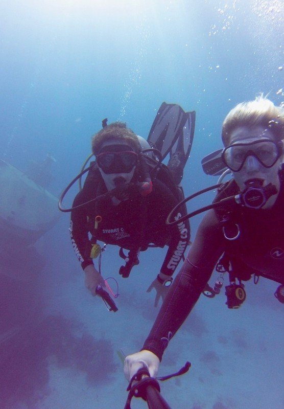 Two scuba divers explore a wreck in The Bahamas