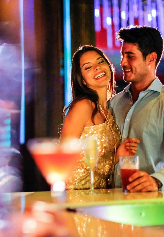Woman and man in nightclub smiling