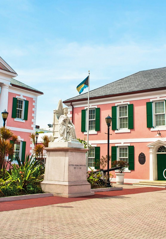Two pink buildings in Parliament Square, Bahamas.