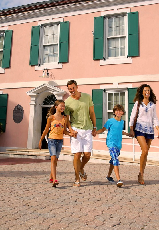 Family in front of historical pink house