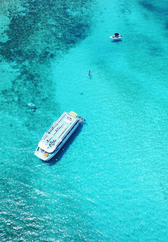 Boat in the blue water aerial view