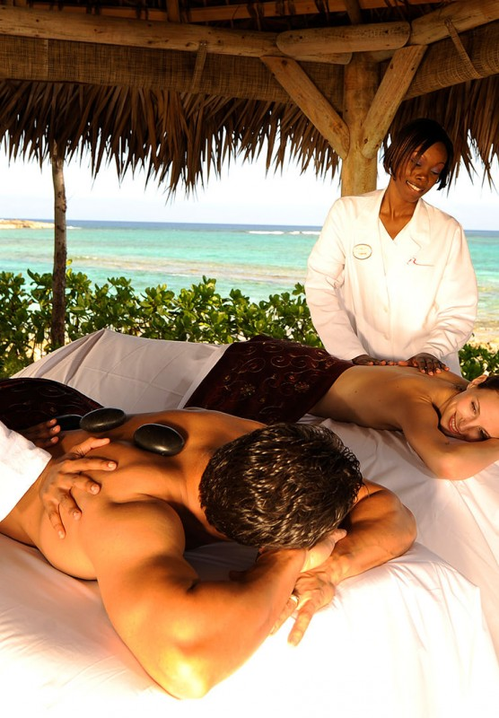 Couple getting massages outside