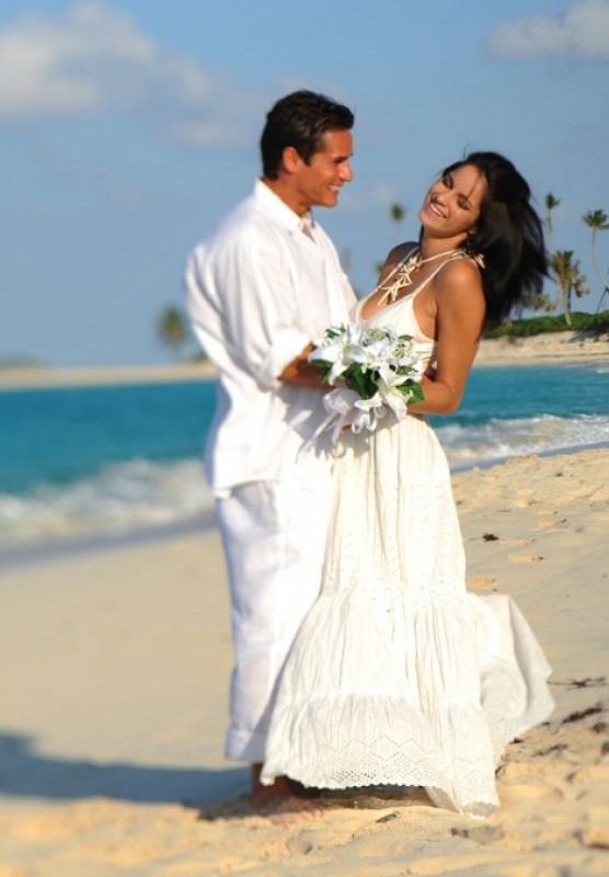 A couple on the beach, just married